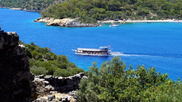 daily boat tour. blue voyage. gemile bay from oludeniz. - tourboat stock videos & royalty-free footage