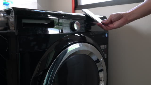 daily chores: laundry at home - utility room stock videos and b-roll footage