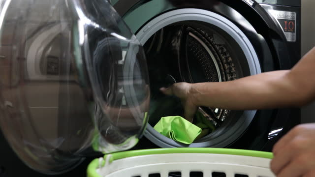daily chores: man laundry at home - loading stock videos & royalty-free footage