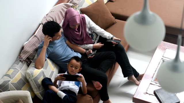 daily home life of a modern family - malay family stock videos and b-roll footage