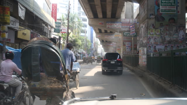 daily life in dhaka in bangladesh - dhaka stock-videos und b-roll-filmmaterial