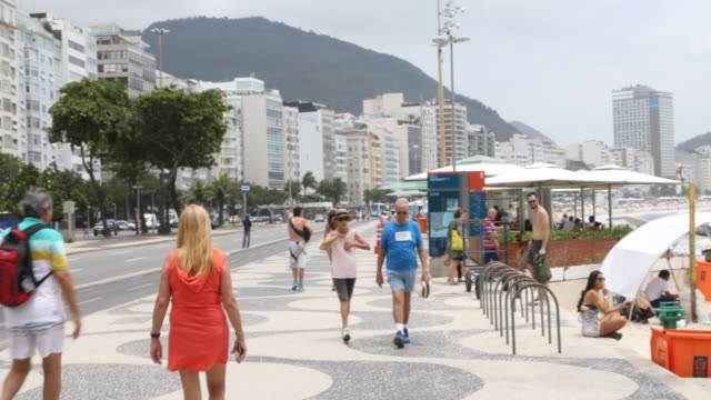 daily life in rio at copacabana beach in brazil - música stock videos & royalty-free footage