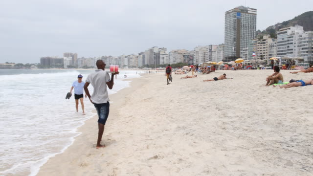 daily life in rio at copacabana beach in brazil - cachaça stock videos & royalty-free footage