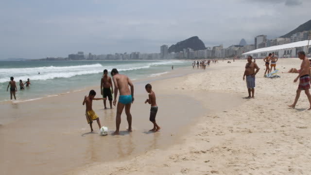 daily life in rio at copacabana beach in brazil - freestyle swimming stock videos and b-roll footage