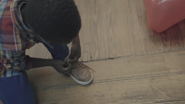 daily life of a child: having fun at home - shoelace stock videos and b-roll footage