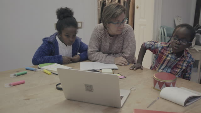 daily life of a child: homework at home with mother - leaning stock videos & royalty-free footage