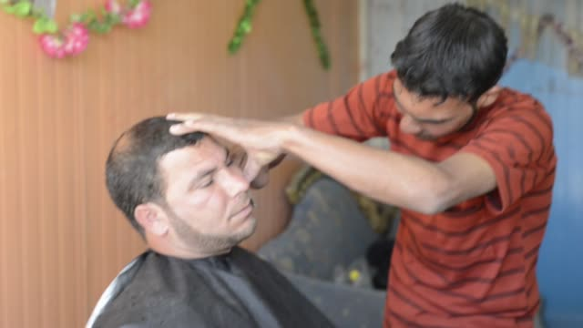 daily life of syrian refugees in zaatari camp - barber shop stock videos and b-roll footage