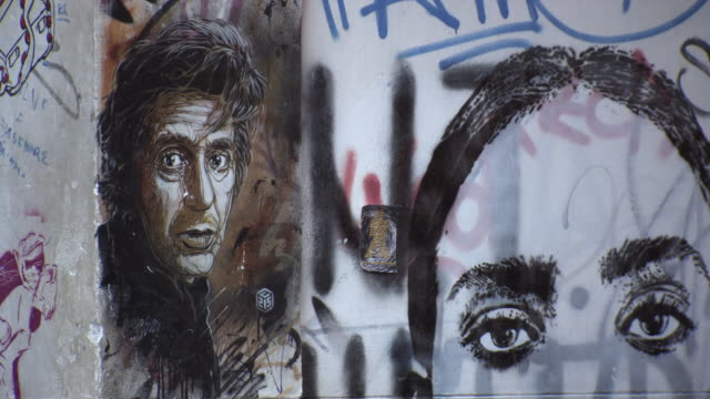 daily life on a graffitied street in palermo - al pacino stock videos & royalty-free footage