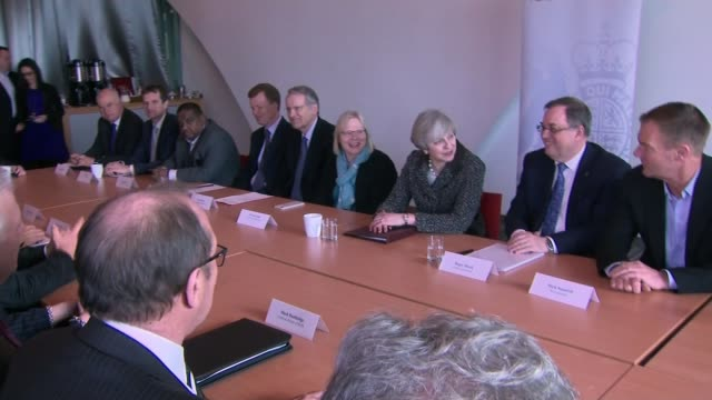 daily mail criticised over sexist headline; birmingham: int theresa may mp seated at table for business and investment forum - デイリーメール点の映像素材/bロール