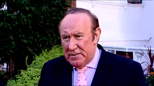 stockvideo's en b-roll-footage met daily mail group's regional paper business announces job cuts andrew neil interview sot shoppers legs along with reading chronicle newspaper... - andrew neil