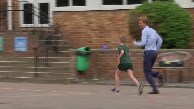 'daily mile challenge' encourages children to run a mile every day; london, uk; kids running the daily mile challenge. england: london: southgate:... - school child stock videos & royalty-free footage