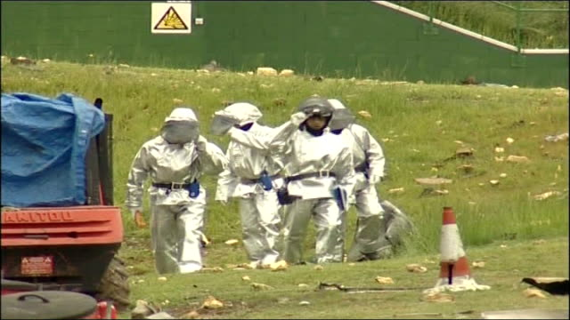 female bomb disposal expert honoured tx england hampshire ext bomb disposal experts in white uniforms along outside wrecked explosives factory - disposal stock videos and b-roll footage