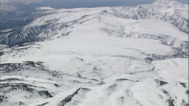daisetsuzan volcanic group in winter, hokkaid__aerial shot - daisetsuzan volcanic group stock videos and b-roll footage