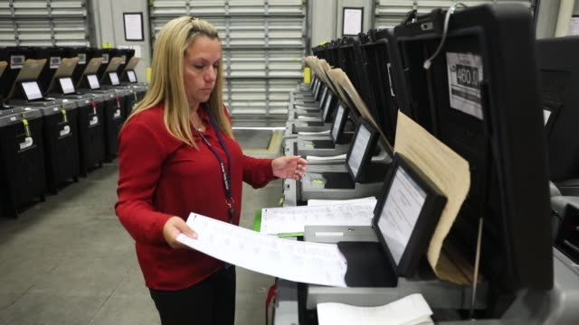 daisy capote a miamidade election support specialists checks voting machines for accuracy at the miamidade election department headquarters on august... - doral stock videos and b-roll footage