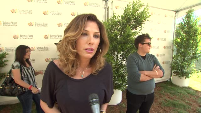 daisy fuentes on her outfit on today's event on the work egpaf does and on what she's looking forward to at 23rd annual 'a time for heroes' celebrity... - daisy fuentes stock videos & royalty-free footage