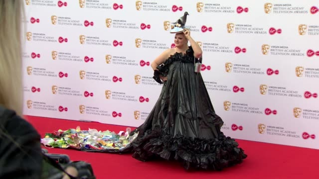 daisy may cooper wearing bin bag dress pose for photos on red carpet at bafta tv awards 2019 at royal festival hall london - royal festival hall stock videos and b-roll footage