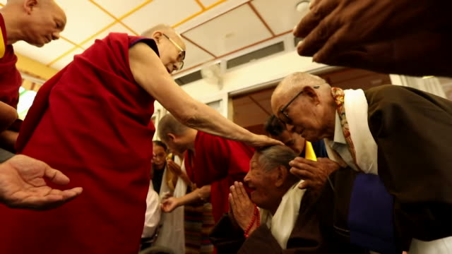 Dalai Lama greeting worshippers in Dharamshala India