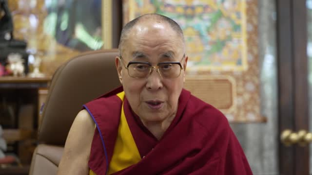 dalai lama interview - cutaways; channel 4 news / the guardian exclusive england: london: gir / india: dharamsala: int cutaways of dalai lama 2-way... - krishnan guru murthy stock videos & royalty-free footage