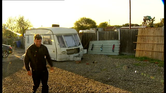 Travellers launch new legal challenges to fight eviction order Woman cleaning and polishing caravan Woman walking away from Traveller's home Len...