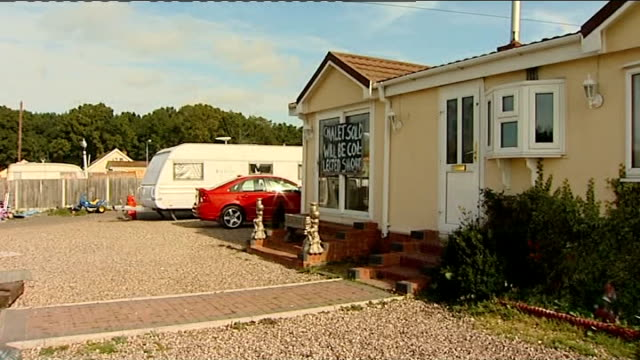 dale farm travellers' site eviction: further delay as high court considers eviction decision; caravan tyres hanging on rack various general views... - basildon stock videos & royalty-free footage