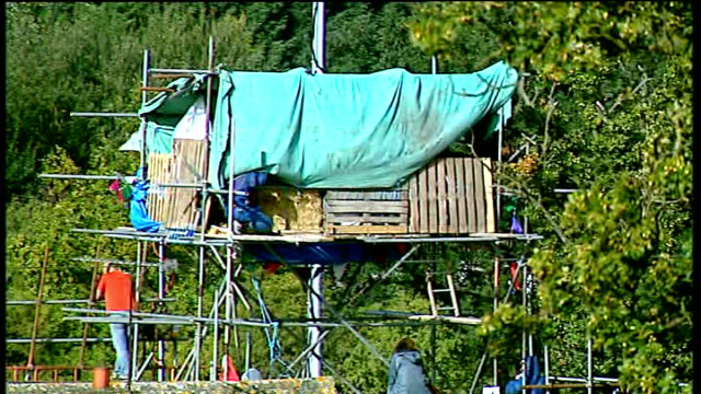 dale farm travellers' site eviction: gloria hunniford arrival / general views protesters and barricades; father christmas banner / shots of rubbish /... - gloria hunniford stock videos & royalty-free footage