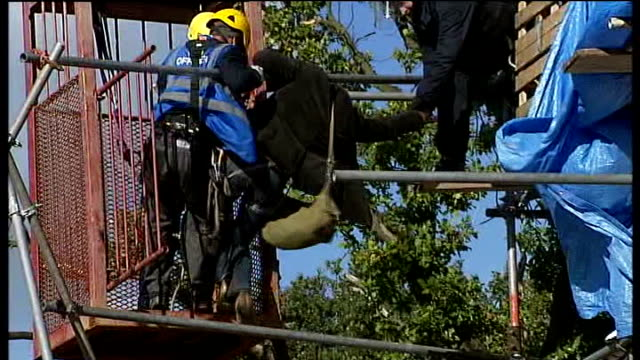 dale farm travellers' site evictions: bailiffs move in; blazing caravan riot police watching activists secured on scaffolding platform activists... - single object stock videos & royalty-free footage