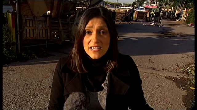 Dale Farm Travellers' site evictions Bailiffs move in Len Gridley interview SOT Reporter to camera Back view of riot police standing at front gate to...