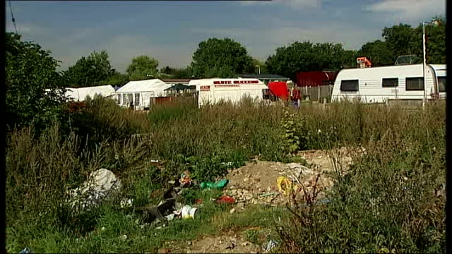 Dale Farm travellers win backing of United Nations in eviction row Banners opposing eviction at site entrance Caravans on travellers' site Jake...