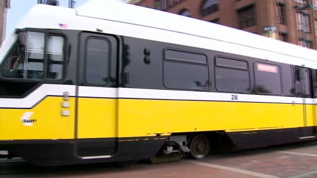 dallas area rapid transit trains driving - ダーツ点の映像素材/bロール
