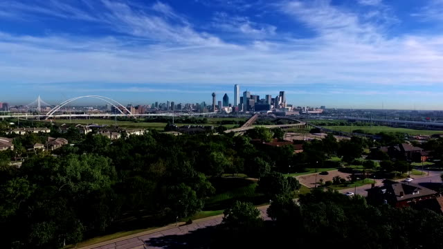 Dallas Texas Downtown Skyline Cityscape in a nice morning with perfect sunny weather a few puffy clouds and nice Summer Sun