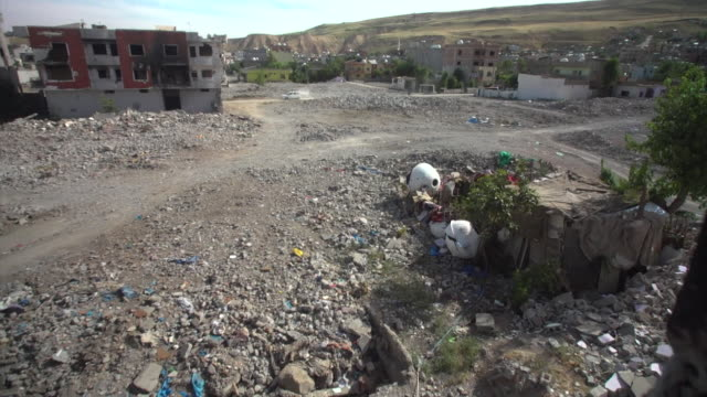 Damage and rubble left in the aftermath of fierce fighting between the Turkish military and Kurdish PKK fighters in the Turkish town of Cizre