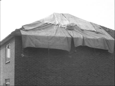 damage caused by thunderstorm at borehamwood; england: hertfordshire: borehamwood: ext gvs damaged house with roof covered with tarpaulin gv rubble... - soot stock videos & royalty-free footage