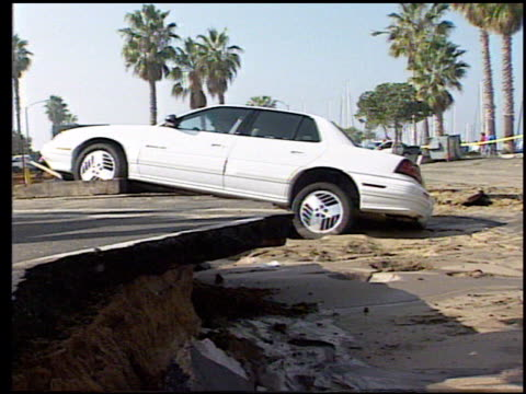 / damage from the northridge earthquake / mudslide damage, houses and cars buried in pacific palisades / damaged parking lot in redondo beach /... - santa monica los angeles video stock e b–roll