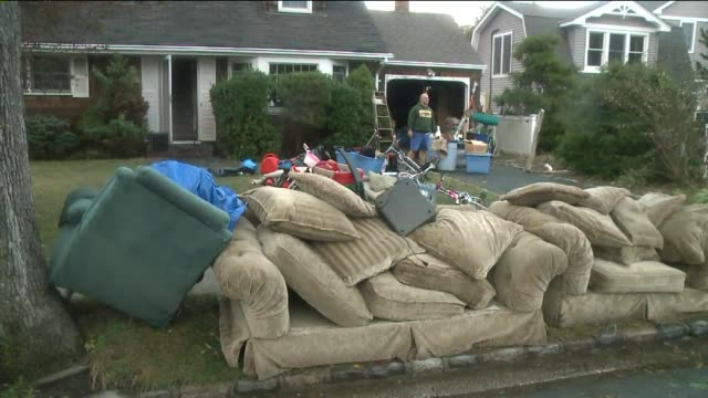 damage in nassau county on long island 14 days after hurricane sandy hit a drenched couch destroyed by flooding on november 12, 2012 in wantagh, new... - drenched stock videos & royalty-free footage