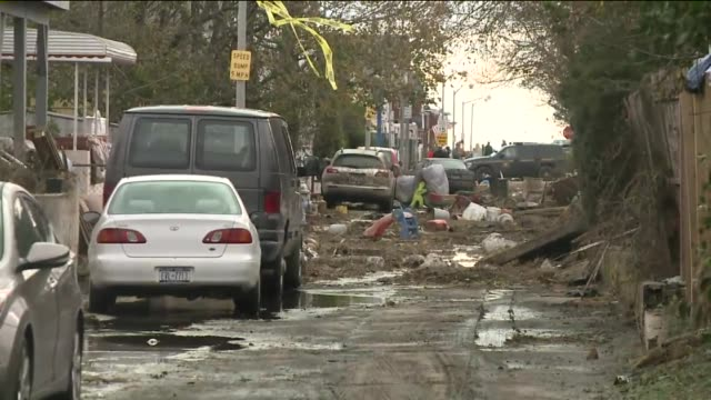 damage in nassau county on long island 14 days after hurricane sandy hit debris on street two weeks after hurricane sandy on november 12 2012 in... - nassau stock videos & royalty-free footage