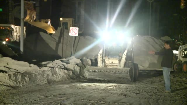 damage in nassau county on long island 14 days after hurricane sandy hit bulldozers sweep sand from street at night on november 12, 2012 in wantagh,... - bulldozer stock videos & royalty-free footage