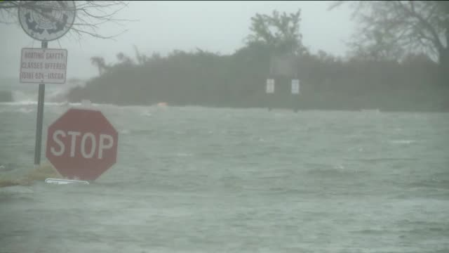 damage in nassau county on long island 14 days after hurricane sandy hit flooding reaches a stop sign at boat dock entrance on november 12 2012 in... - hurricane katrina stock videos and b-roll footage