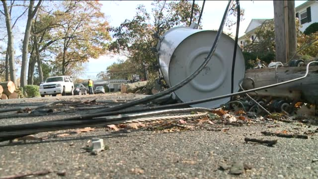 damage in nassau county on long island 14 days after hurricane sandy hit struck down transformer boxes and cables on street on november 12 2012 in... - nassau stock videos & royalty-free footage