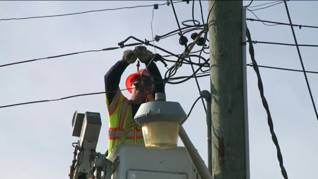 stockvideo's en b-roll-footage met damage in nassau county on long island 14 days after hurricane sandy hit an electrical engineer works on a transformer box on november 12, 2012 in... - stroomtransformator