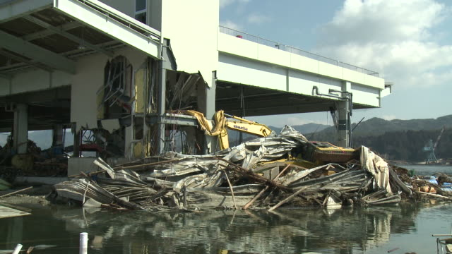 damage in port area of kesennuma city, japan filmed on 1 april 2011, 3 weeks after a tsunami which was caused by magnitude 9 tohoku earthquake off north east japan / audio - earth mover stock videos & royalty-free footage