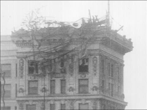 B/W 1914 damage on top of building after storm / San Francisco / newsreel