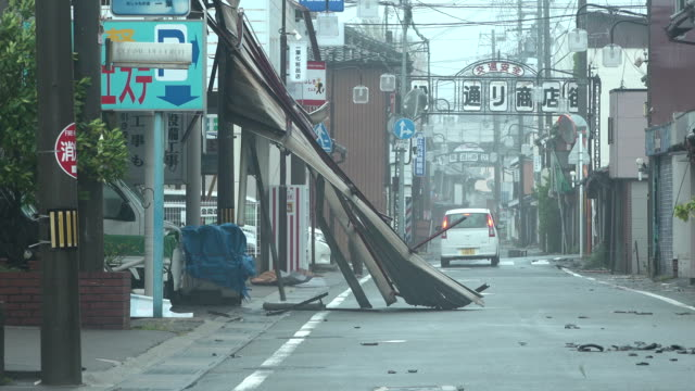 damage to buildings and debris in street after typhoon jebi hit central japan - typhoon stock videos & royalty-free footage