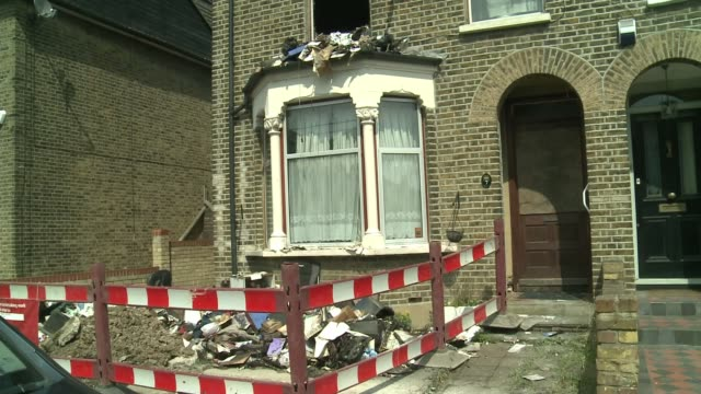 damage to homes in london following electrical storm england essex romford ext house with broken window and rubble in front garden surrounded by red... - thunderstorm stock videos & royalty-free footage