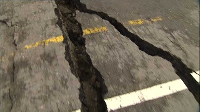 Damage to Port of Lyttelton with large cracks and fissures in concrete wharf