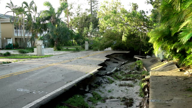 damage to road in naples, florida in aftermath of hurricane irma - naples florida stock videos & royalty-free footage