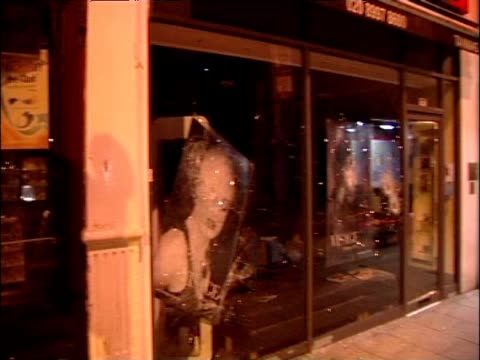 Damage to shops following looting in the area