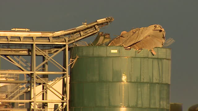 damage to silo tank containing biosolids where explosion took place killing four employees of wessex water sewage treatment works in avonmouth - environmental issues stock videos & royalty-free footage