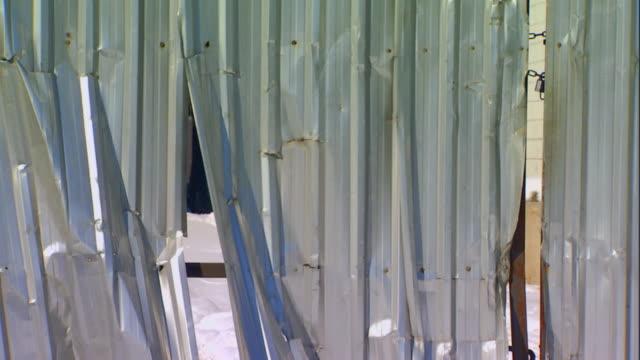 Damaged aluminum wall