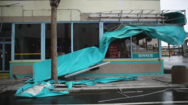 a damaged awning is seen as winds from hurricane florence on september 14 2018 in myrtle beach united states hurricane florence is hitting along the... - carolina beach stock videos and b-roll footage