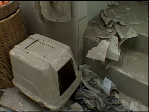 VS damaged bathroom with toilet cat litter box bathtub full of debris in Liberty St apartment near Ground Zero after the September 11 2001 terrorist...
